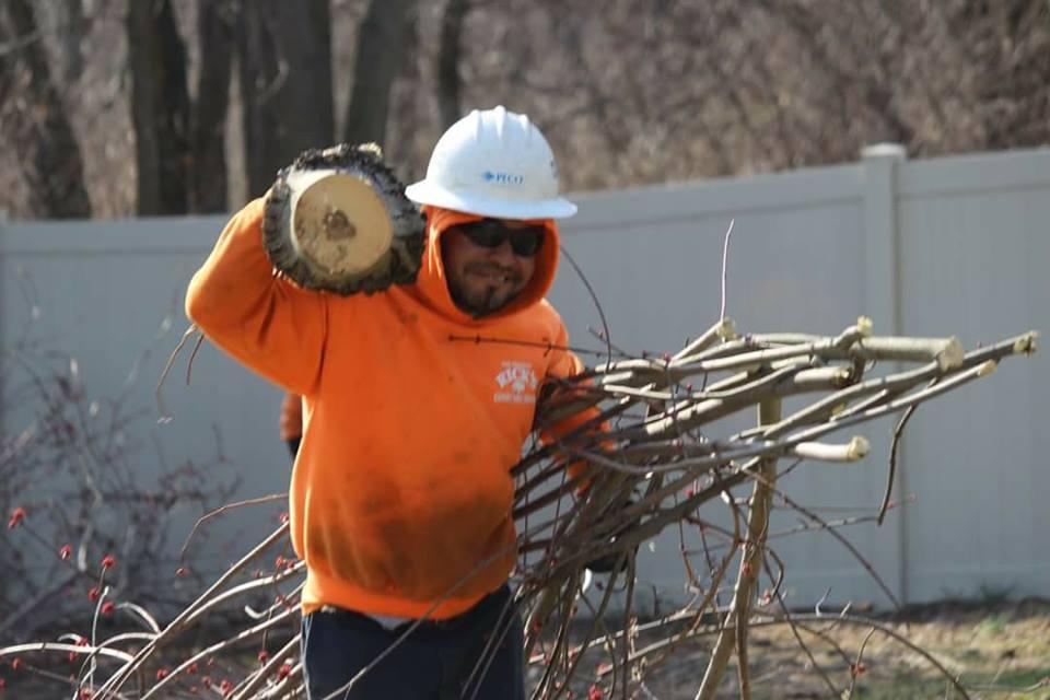 groundsman clearing wood debris